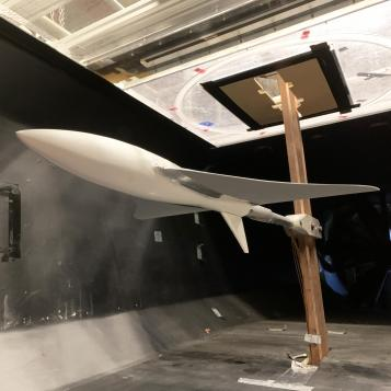 Image of the UAV model suspended in a wind tunnel